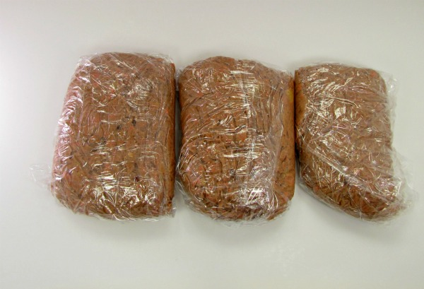 3 loaves of carrot cake cookie dough in plastic wrap