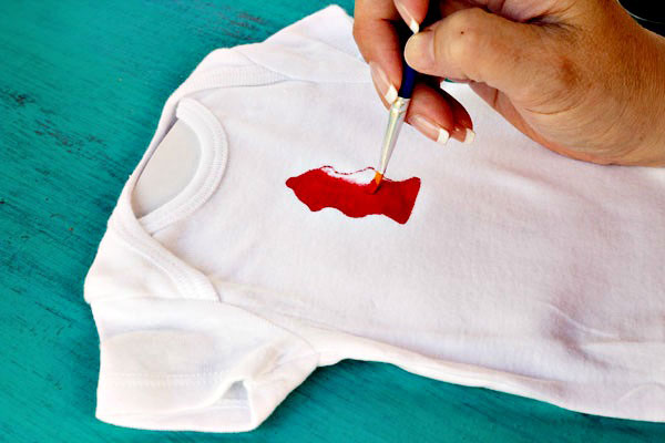 Super cute DIY Onesies made with Cookie Cutters. These make the perfect baby shower gift! So easy to do!