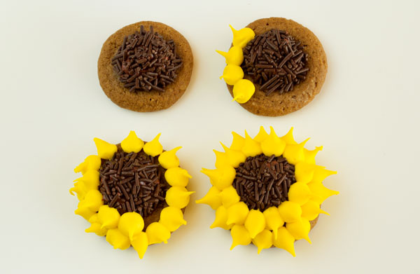 Decorated Thumbprint Cookies Simple little Sunflowers via thebearfootbaker.com