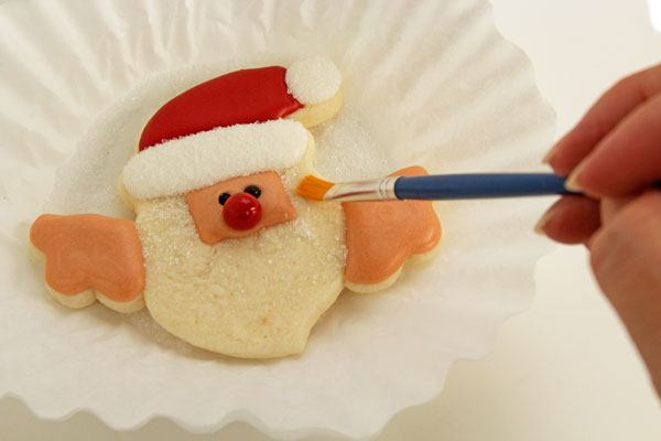 Cute santa cookies that hang on a cup with thebearfootbaker.com