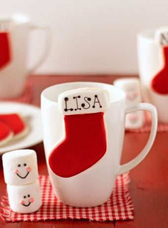 Cute Stocking Place Card Cookies via www.thebearfootbaker.com