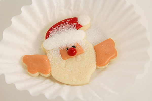 Santa cookies that hang on a cup with thebearfootbaker.com