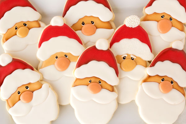 santa cookies via wwwthebearfootbakercom - Cookie Decorating