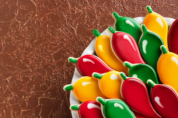 How to Decorate Chili Pepper Cookies with Royal Icing via thebearfootbaker.com
