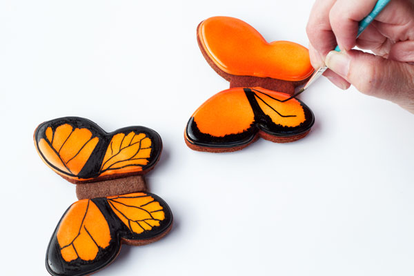 Simple Butterfly Cookies - Easy to decorate butterfly cookies and a step by step tutorial by thebearfootbaker.com