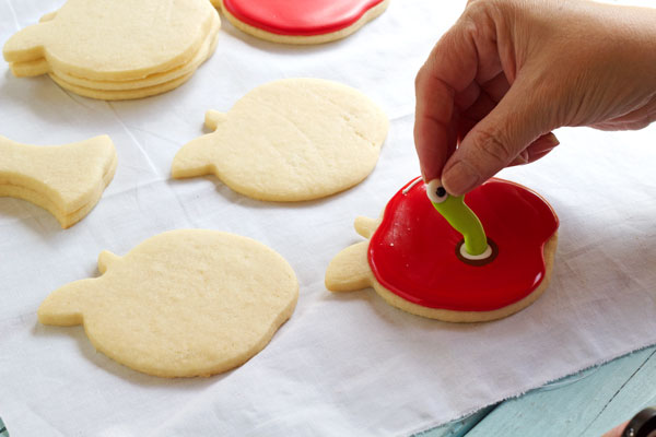 Cute Apple with Worm Cookies - Sugar Cookies Decorated with Royal Icing by thebearfootbaker.com