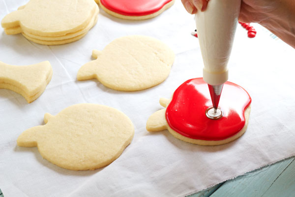 Simple Apple with Worm Cookies - Sugar Cookies Decorated with Royal Icing via thebearfootbaker.com