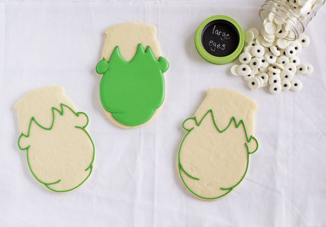 easy frankenstein cookies for halloween sugar cookies decorated with royal icing via wwwthebearfootbaker