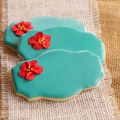 Edible Apple Blossoms made from Royal Icing or Buttercream. Great for cookie, cupcake and cake decorations via thebearfootbaker.com