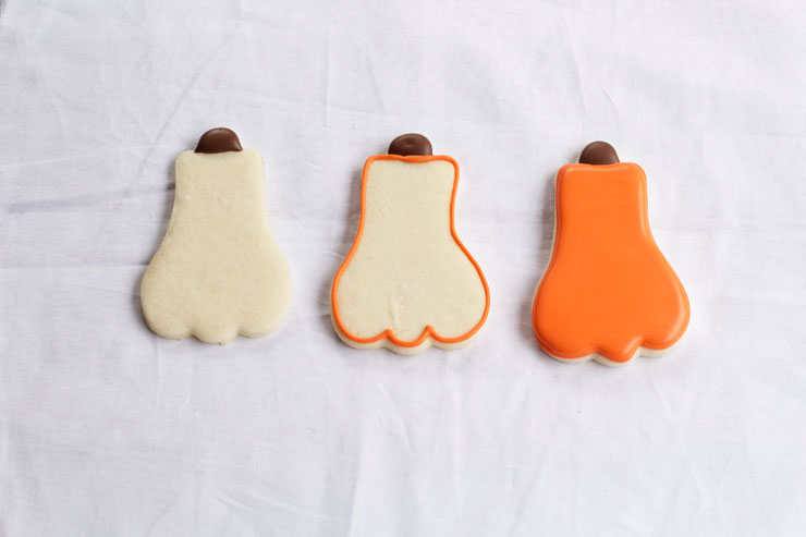 Decorated Pumpkin Cookies are Easy Sugar Cookies Decorated with Royal Icing via thebearfootbaker