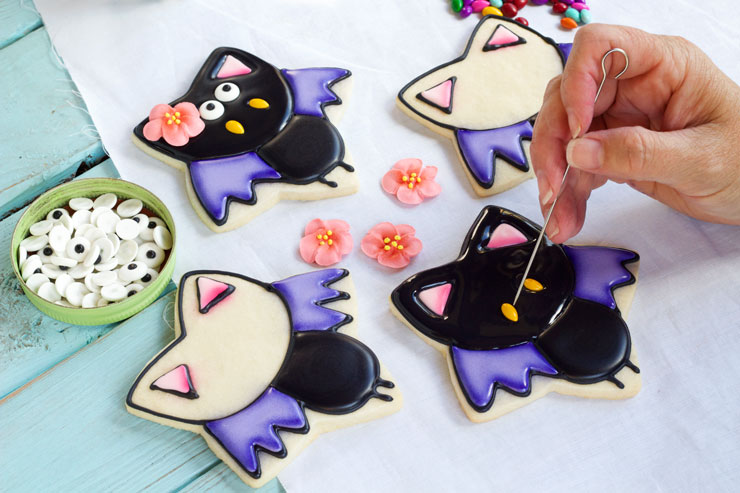 Easy Bat Cookies for Halloween- Girl bats via thebearfoootbaker.com