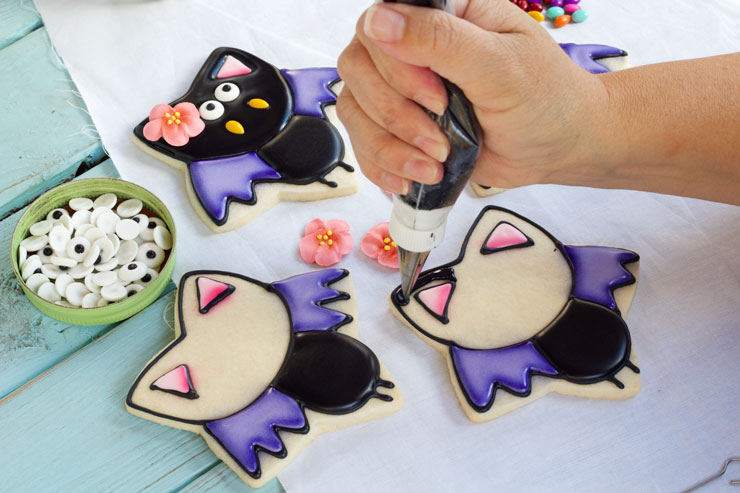 Easy Bat Cookies for Halloween- Girl bats with www.thebearfoootbaker.com
