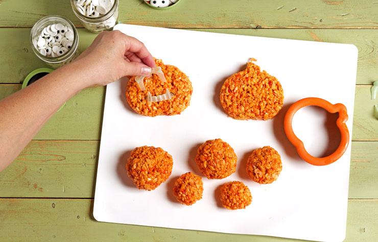 Easy Pumpkin Rice Krispie Treat Zombies for Halloween thebearfootbaker.com