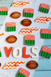 Make some Simple Decorated Football Cookies for your next big game. You can customize them for your favorite team. They are sugar cookies decorated with royal icing. via www.thebearfootbaker.com