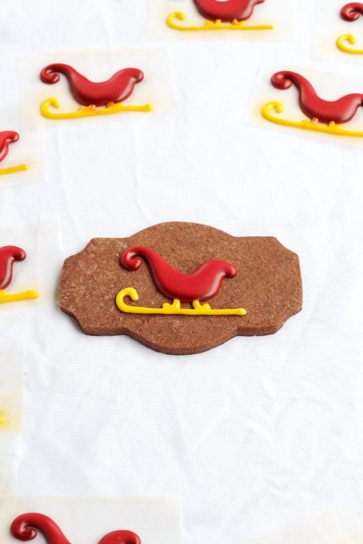 DIY Royal Icing Transfers that are made with a Cookie Stencil via thebearfootbaker.com
