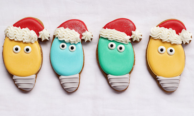 Easy Christmas Light Cookies with a Santa Hat - Sugar Cookies Decorated with Royal Icing by www.thebearfootbaker.com