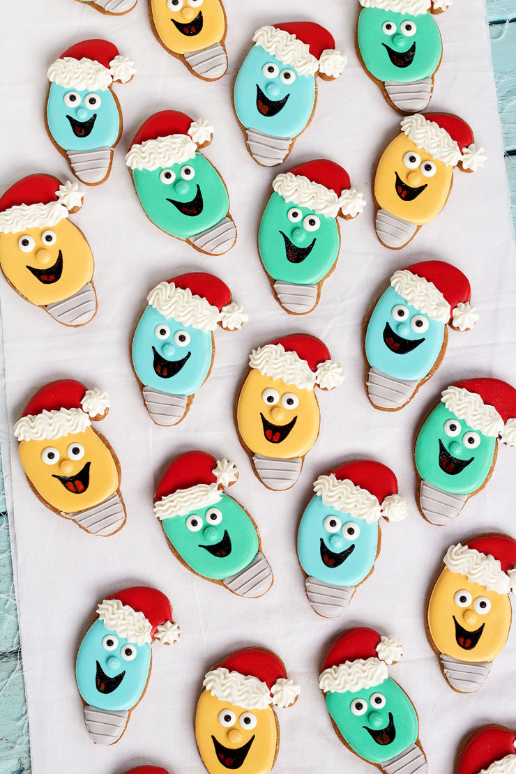 Easy Christmas Light Cookies with a Santa Hat - Sugar Cookies Decorated with Royal Icing. via www.thebearfootbaker.com
