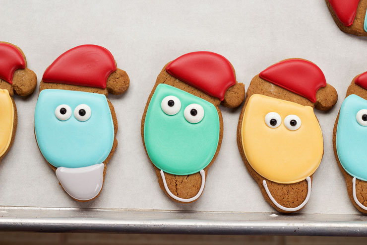 Easy Christmas Light Cookies with a Santa Hat - Sugar Cookies Decorated with Royal Icing. with www.thebearfootbaker.com