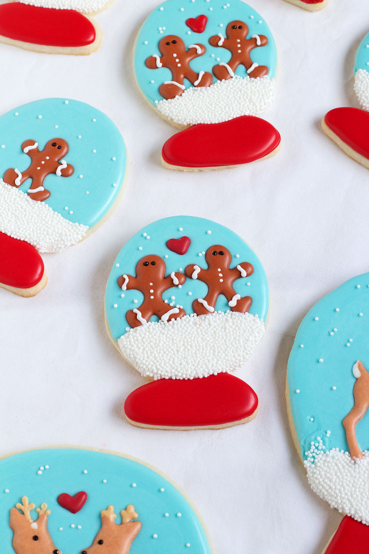 Easy Christmas Royal Icing Transfers - Simple Gingerbread Men and Reindeer Edible Candy for Cookie Decorating via www.thebearfootbaker.com