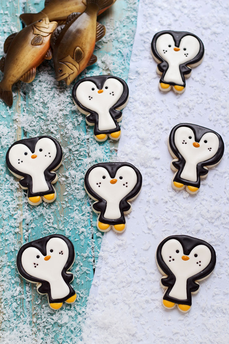 Easy Penguin Cookies - Cut out sugar cookies decorated with royal icing via thebearfootbaker.com