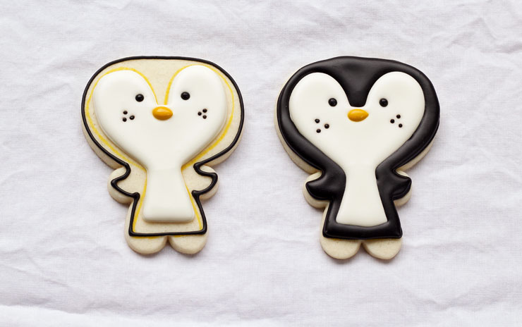 Easy Penguin Cookies - Cut out sugar cookies decorated with royal icing via www.thebearfootbaker.com