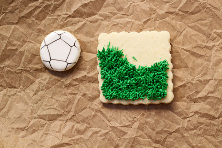 Soccer Cookies- Simple Cut Out Sugar Cookies Decorated with Royal Icing via www.thebearfootbaker.com