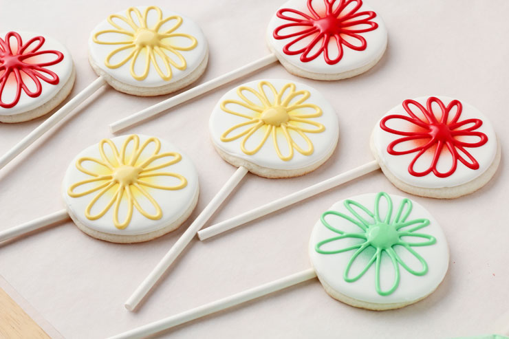 Easy Whimsical Flower Cookie Pops via www.thebearfootbaker.com