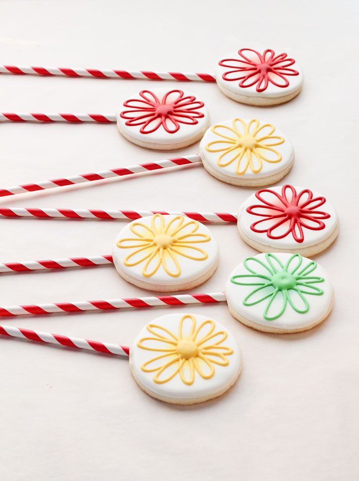 Simple Flower Cookie Pops via www.thebearfootbaker.com