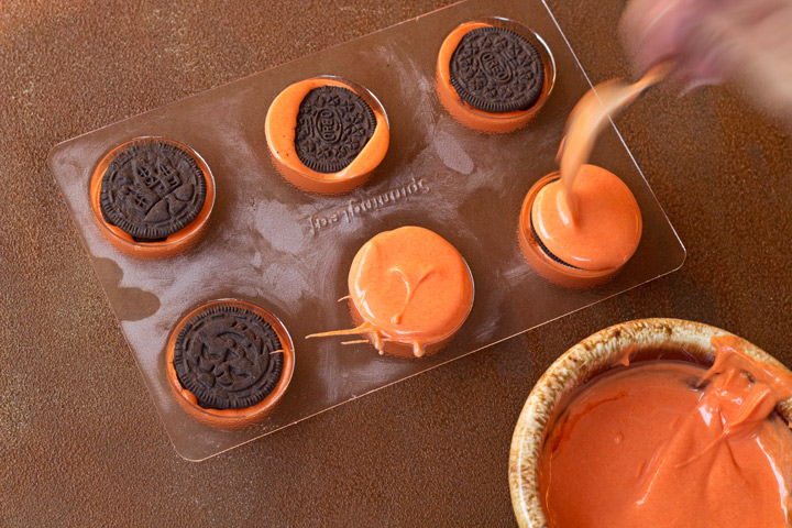 Simple Chocolate Covered Pumpkin Oreo's with a Video Tutorial | The Bearfoot Baker